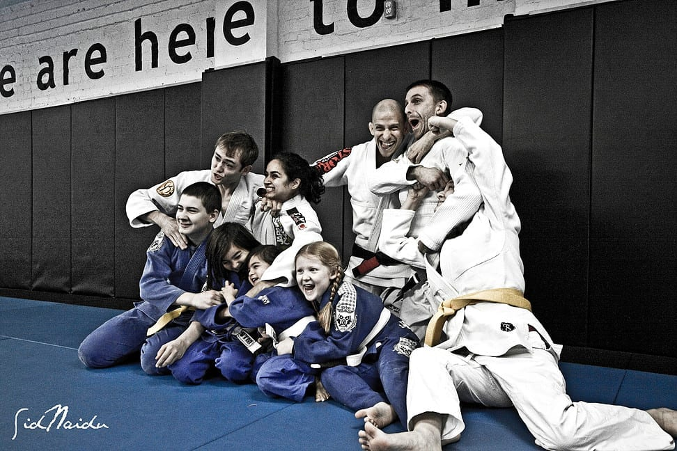 Group of kids martial arts students making funny faces