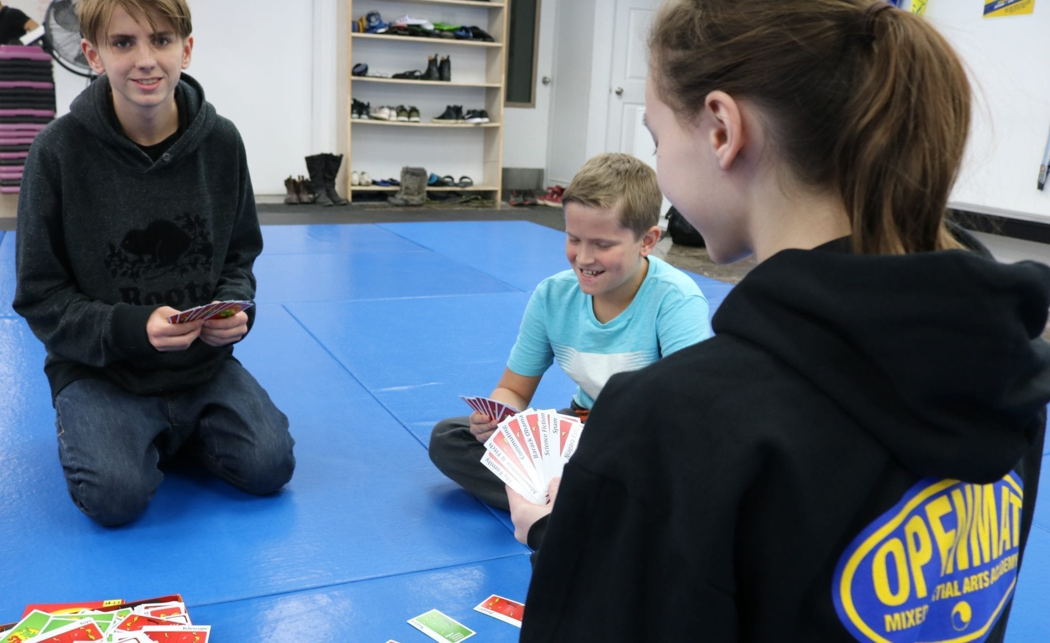 summer camp kids playing board game