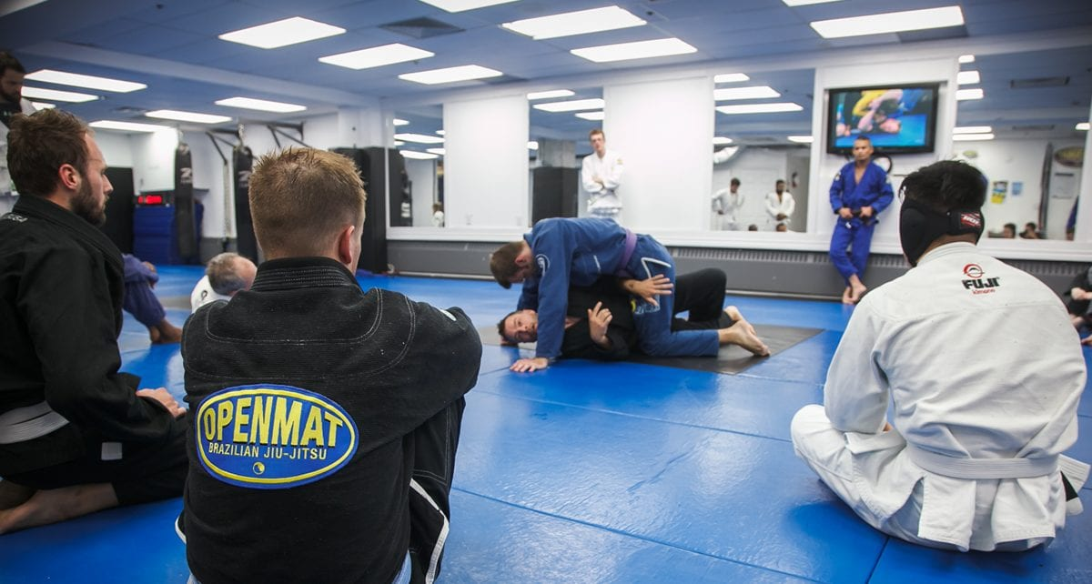 People watching a BJJ instructor teach a technique