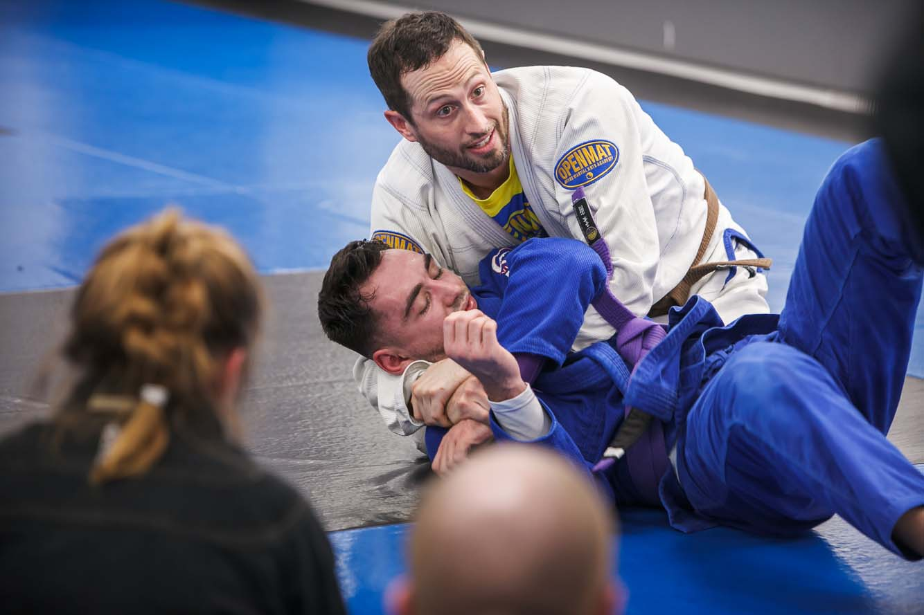 BJJ Instructor showing the class a Brazilian jiu jitsu technique