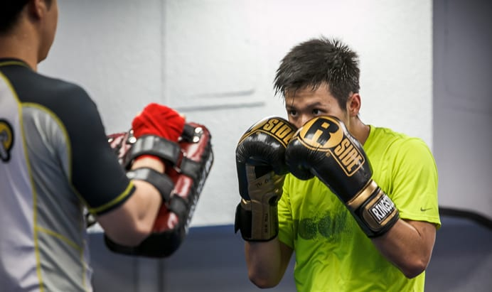 Man with Muay Thai Gloves on