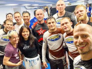 Group picture of people in No Gi BJJ clothing